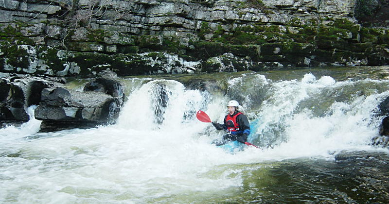 Short, brightly-coloured whitewater kayaks ... Redmire Force on the River Ure (grade 3). Paddler: Heather Florence. Photo: Andy Waddington.